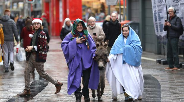 Mary (Figueira Beckie) and Joseph (Sean Jordan) take the donkey to the Live Crib at St Mary's Church