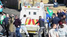 Trouble flares in the Lake Street area of Lurgan as nationalist youths throw stones at police and set a wheelie bin on fire on the railway line yesterday