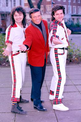 Top of the pops: DJ Tony Blackburn with Bay City Rollers Ian Mitchell and Les McKeown