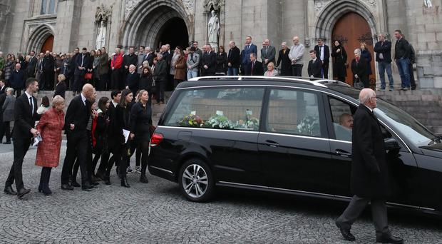 Family and friends walk behind the hearse carrying the coffin of well-known filmmaker and media consultant Matt Curry following a funeral Mass at St Patrick's Cathedral in Armagh