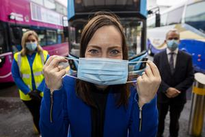 Infrastructure Minister Nichola Mallon at at Europa Buscentre and Great Victoria Street Rail Station in Belfast, with a face mask to remind people to wear one when travelling on public transport (Liam McBurney/PA)