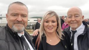A photo posted on Lucan Sinn Fein Facebook page of Michelle O'Neill posing for a selfie with attendees at Bobby Storey's funeral (Lucan Sinn Fein Facebook/PA)
