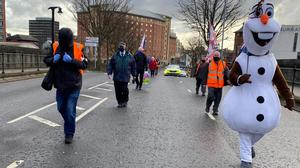 The socially distanced protesters made their way from Sandy Row Orange Hall to the city centre, followed police officers (Cate McCurry/PA)