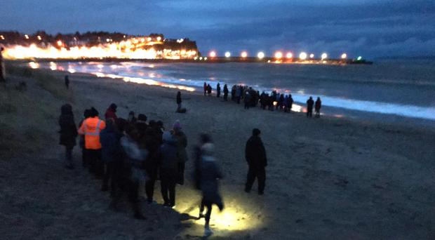 Family and friends of Deirdre McShane gather at Ballycastle beach early on Tuesday (Q Radio/PA)
