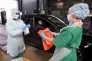 Medical staff demonstrate how they take samples at an MOT testing centre in Belfast (Justin Kernoghan/PA)