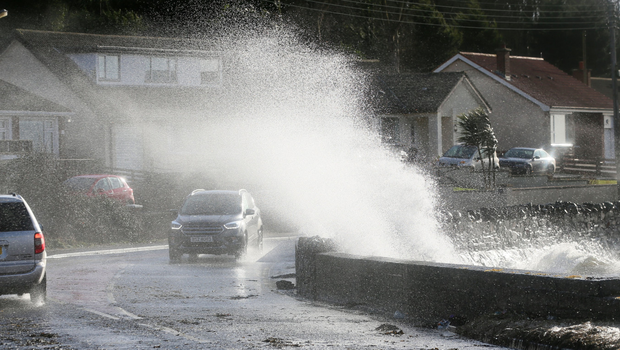 Waves crash into a sea wall next to the Portaferry Road, Co Down