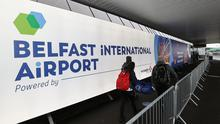 Travellers arriving at Belfast International Airport for their flights. (Liam McBurney/PA)