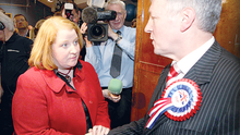 Peter Robinson congratulates Naomi Long on her victory