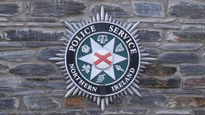 A stock picture of a Police Service of Northern Ireland (PSNI) logo badge (Niall Carson/PA)