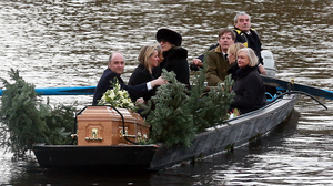 Viscount Crichton and the Countess of Erne bring Lord Erne to his funeral service at his beloved Crom estate