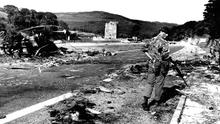 The aftermath of the IRA double bomb attack that killed 18 soldiers at the historic site in 1979
