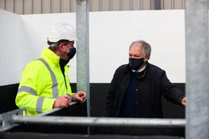 Changes: Northern Ireland's Chief Veterinary Officer, Dr Robert Huey (right), during a visit to view the progress on the new Point of Entry facilities at Duncrue Industrial Estate, Belfast