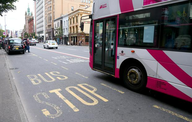 A Stormont minister may be summoned to Belfast City Hall to face questions over bus lanes