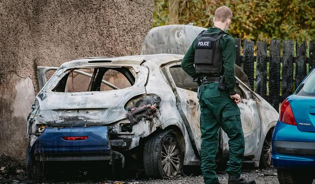 Investigation: Police at the scene of the suspected arson attack on Quarry Road in Gulladuff. Credit: Kevin Scott / Belfast Telegraph