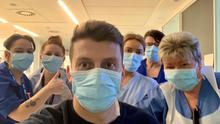 Mark with staff at the hospital