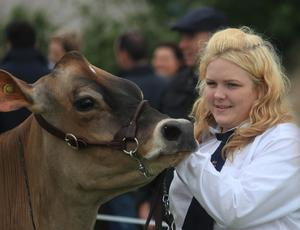 Enjoying the Omagh Show are Ellie McLean with her Jersey cow