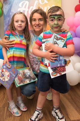 Twins Aoife and Adam celebrate fourth birthday yesterday with their mum Bronagh and some of the 3,000 cards they received from around the world