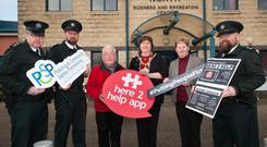 Inspector Marc Riddell, Chief Inspector William Calderwood, PJ McAvoy, Chair of Ballymena North, Mayor Maureen Morrow, Jackie Patton of Mid and East Antrim Borough Council, and Inspector Rory Bradley at the launch of the #Here2Help roadshow