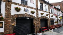 Frustration has been expressed over the announcement that non-essential retail, pubs and restaurants for two weeks (Liam McBurney/PA)