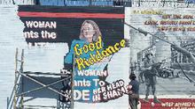 The sabotaged mural of former Northern Ireland Secretary of State Theresa Villiers on the International Peace Wall in west Belfast