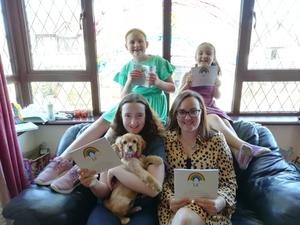 English teacher Emma and her three daughters Victoria, Abigail and Isabella with Honey the dog