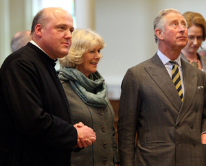 The Prince of Wales and the Duchess of Cornwall, with Rev Brian Stewart (left), rector of St George's Church, in Belfast