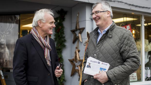 Tom Elliott chats with antique shop owner Ian Black while canvassing in Enniskillen (Liam McBurney/PA)