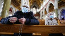 New world: Parishioners at Mass in St Peter's Cathedral, west Belfast, but many now watch services online