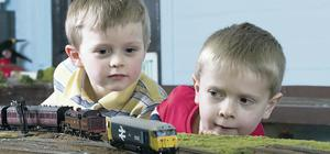 Felix McIlduff and Joshua McLaughlin watch the trains