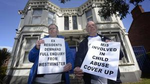 Former Kincora residents Clint Massey and Gary Hoy protest yesterday outside the building in east Belfast