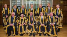 Back row, from left: Lord Toulson, Lord Carnwath, Lord Sumption, Lord Wilson, Lord Reed, Lord Hughes, Lord Hodge. Front row, from left: Lord Kerr, Lady Hale, Lord Neuberger, Lord Mance, Lord Clarke