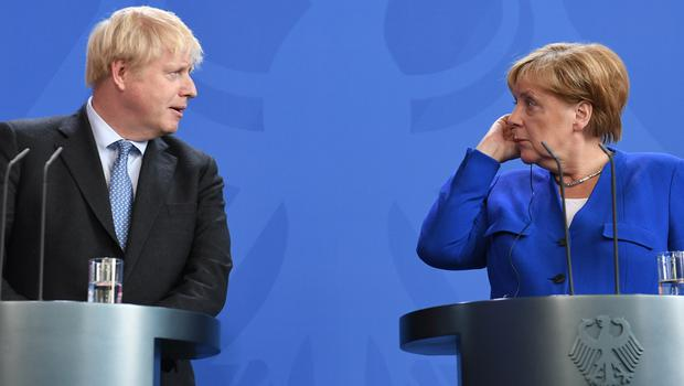 Prime Minister Boris Johnson with German Chancellor Angela Merkel in Berlin (Stefan Rousseau/PA)