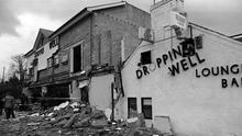 The scene of the bomb devastation at the Droppin Well pub in Ballykelly in 1982 (PA)