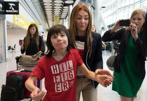 Charlotte Caldwell and her son Billy at Heathrow Airport after having a supply of cannabis oil used to treat his severe epilepsy confiscated on their return from Canada (Stefan Rousseau/PA)