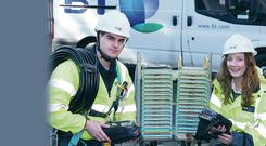 Apprentice James Tohall with head of field engineering Mairead Meyer on the first day of the BT apprenticeship programme at the company's training centre in Antrim
