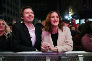 Actress Bronagh Waugh watches the lights switch on