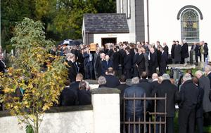 Friends and family carry the coffin of farmer Alastair Sloss following his funeral at Saltersland Presbybterian Church in Moneymore