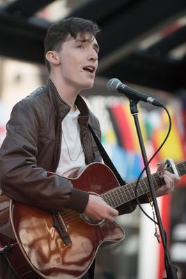 Cathal O'Connell performing on stage in Derry