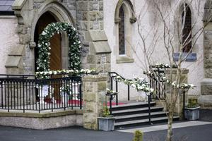 The  Church of the immaculate Conception, Newtownbutler, with the wedding flowers in the entrance