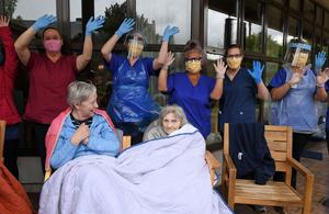 Nursing staff and residents waved their arms in the air and danced together as Dave sang