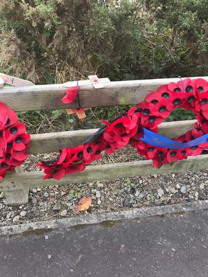 Ruined Poppy wreaths at the Narrow Water memorial (Memorial to the Narrow Water Massacre/PA)