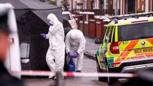 Police at the scene of the murder of Warren Crossan on Saturday