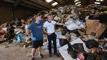 DUP councillor Brian Kingston with resident Gary Lenaghan inside the warehouse