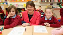 New First Minister Arlene Foster meets pupils Dylan McKinstry and Casey Richardson at Pond Park Primary School in Lisburn yesterday; right, with Paul Givan MLA