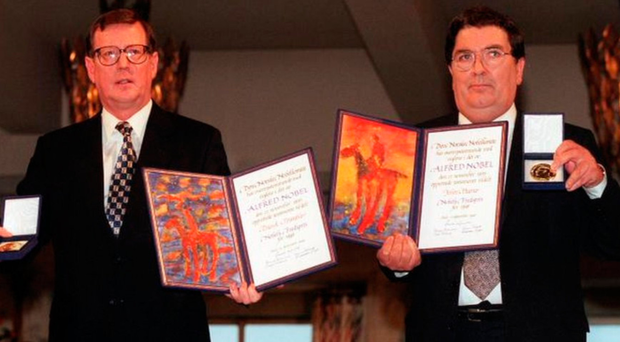 Mr Hume and David Trimble with their prizes in 1998
