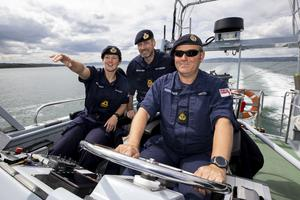 L-R Commanding Officer Lt Rebecca Anderson Royal Navy abroad HMS Biter with Senior Naval Officer Northern Ireland, Commander John Patterson, and CPO (ETME) Graeme Hinton at the helm during Ship's in Company Close-in Manoeuvring along the north Antrim coastline. The coronavirus pandemic has thrown up logistical challenges on board a war ship which trains the commanding officers of the future. PA Photo. Picture date: Tuesday July 21, 2020. See PA story DEFENCE Biter. Photo credit should read: Liam McBurney/PA Wire