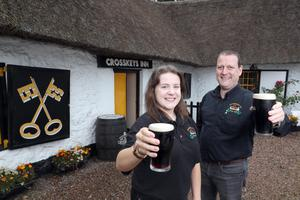 Doors open: Father and daughter publicans Ciara and Vincent Hurl toast the re-opening of the Crosskeys Inn, Co Antrim