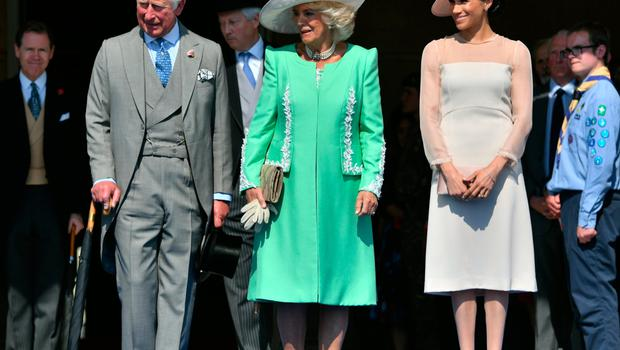 Prince Charles and wife Camilla, Duchess of Cornwall with Meghan, Duchess of Sussex at Garden Party at Buckingham Palace