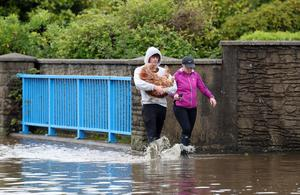 Emergency services attend flooding near the Shimna River and at Bryansford Avenue, Newcastle