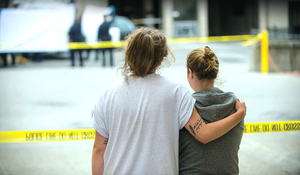 Two students comfort each other at the scene of the Berkeley balcony collapse